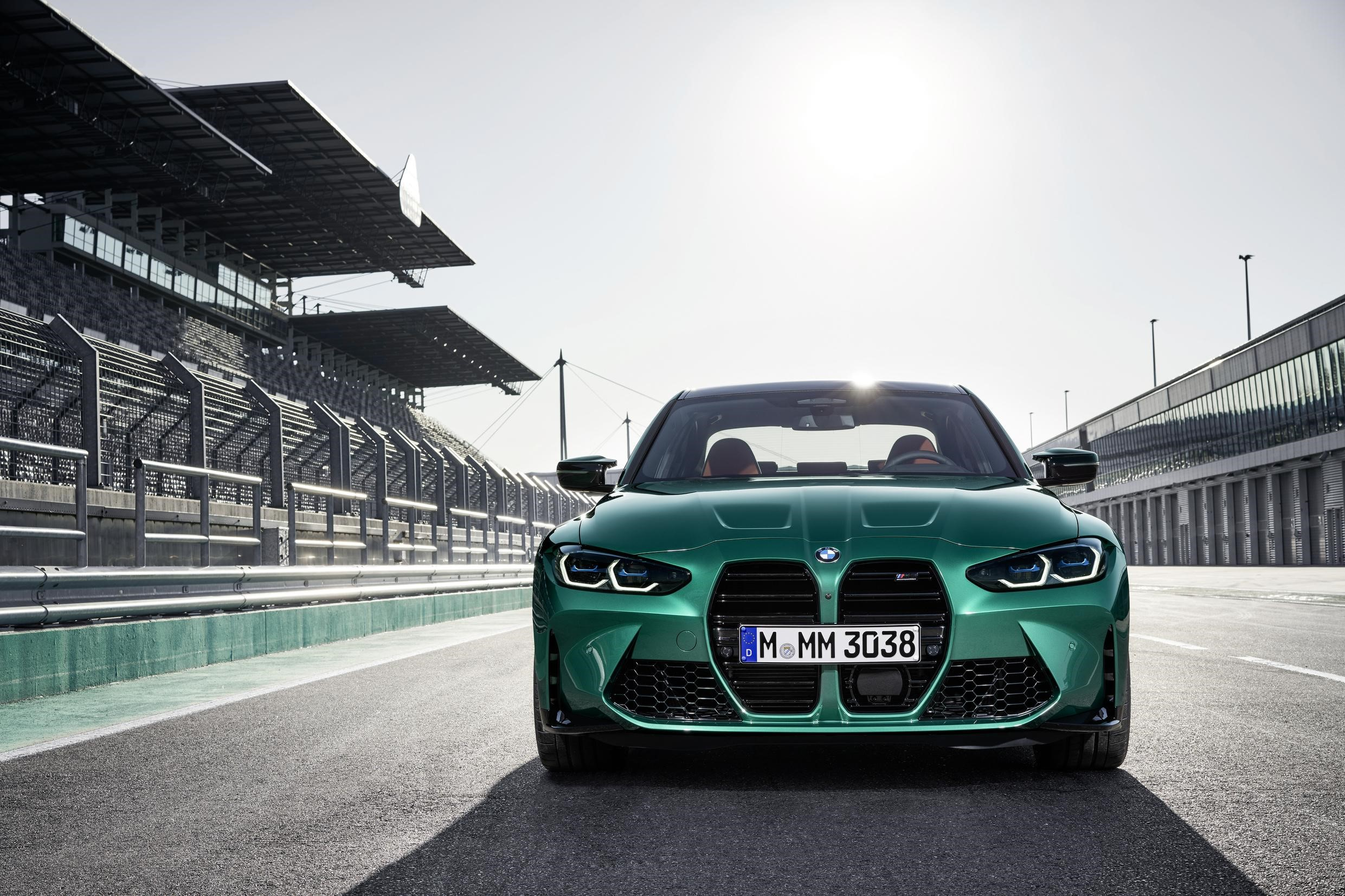 Teal BMW M4 Front Driving